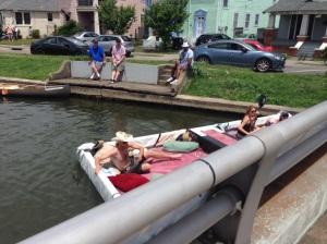 Homemade raft floating down the bayou...